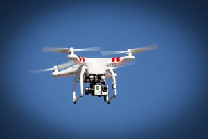 Image of a red and white drone in flight.