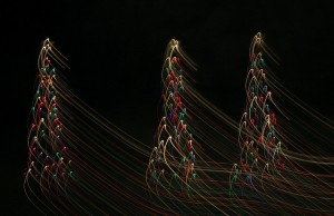 Image of christmas trees with blurred lights to symbolize the effect of holiday drinking.