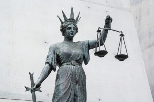 Lady justice holding scales at supreme court.