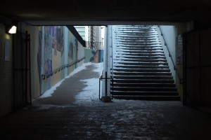 Icy city stairs covered with snow and potential for injury and lawsuit.