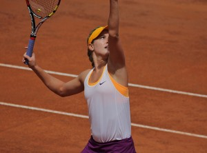 Image of Canadian tennis pro Eugenie Bouchard serving a ball.