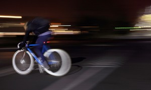 Person riding a bike at night that could lead to a serious spinal injury and require serious treatment for injuries.
