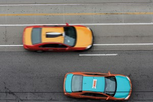Two taxis from aerial view.