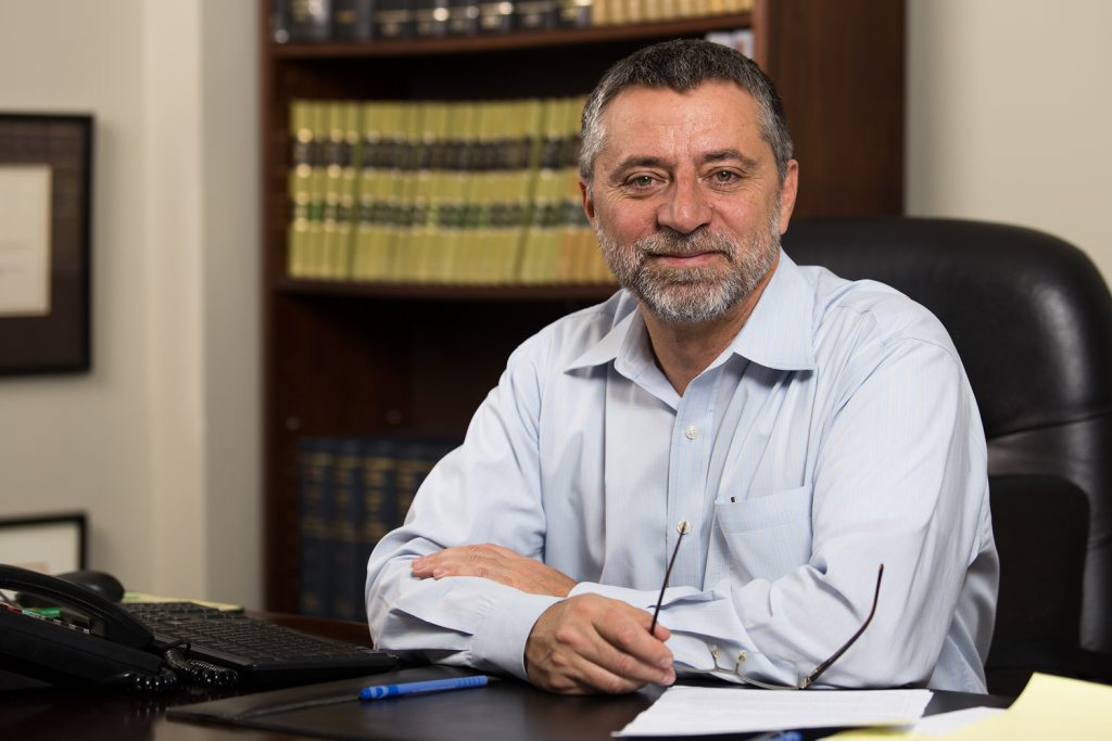 Personal injury lawyer, Antonio Azevedo sitting at his desk.